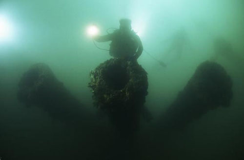Underwater canon on shipwreck by David Doubilet